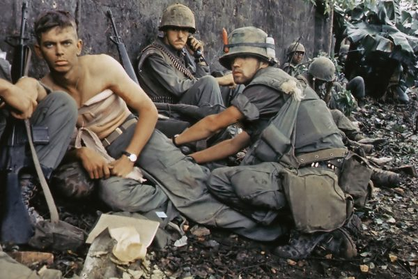Vietnam War Tour - Marine gets his wounds treated during operations in Huế City, 1968