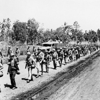 Guadalcanal Campaign Tour - Troops of U.S. forces on Guadalcanal march over a newly scraped road