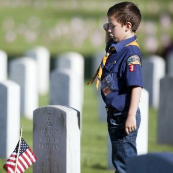 Flags placed on graves at Fort Custer National Cemetery for Memorial Day