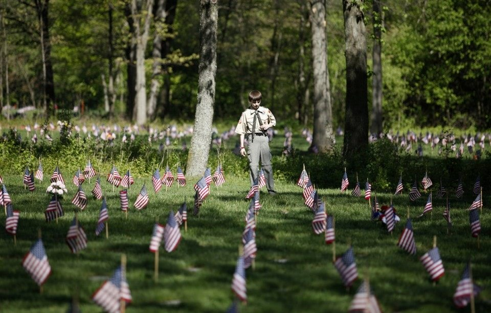 Finding Relatives - Volunteers place flags on Fort Custer National Cemetery graves - Mat McLachlan Battle Tours