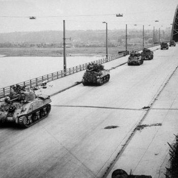 Arnhem. September 1944 -Allied Sherman tanks crossing the newly-captured bridge at Nijmegen in Holland - Holland Battlefield Tours