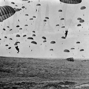 Parachutes open as waves of paratroops land in Holland during operations by the 1st Allied Airborne Army in Sept 1944. Operation Market Garden was the largest airborne operation in history, with some 15,000 troops landing by glider and another 20,000 by parachute - Holland Battlefield Tours