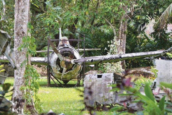 Wreckage of American Grumman Wildcat fighter plane in outdoor Vilu War Museum, Guadalcanal, Solomon Islands - Guadalcanal 75th Anniversary Tour