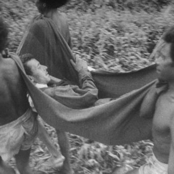 Wounded soldier carried by locals - New Guinea Campaign 75th Anniversary Tour