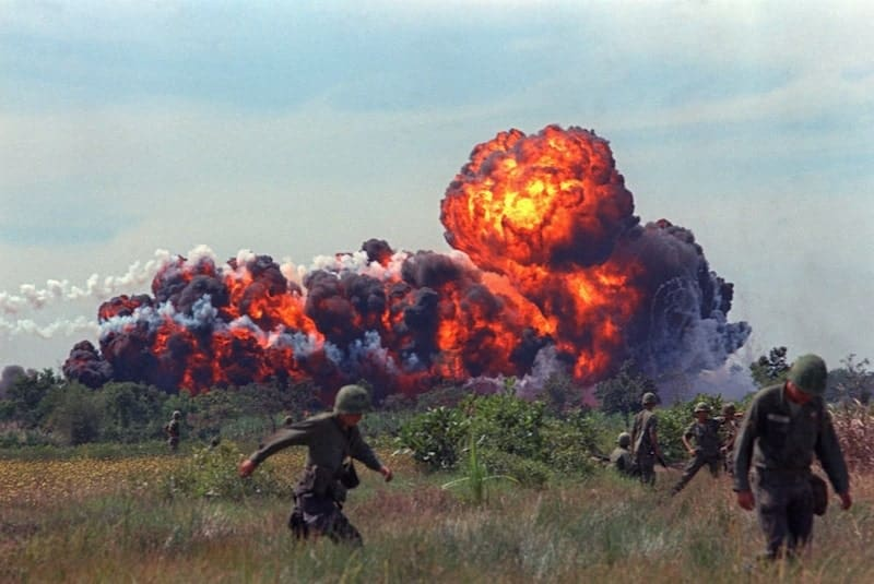 A napalm attack near US troops on patrol in South Vietnam, circa 1966 - Vietnam Revealed
