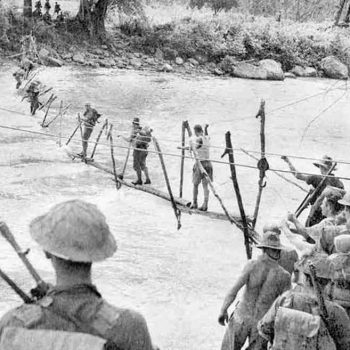 Advancing to the coast Australian soldiers crossing an improvised bridge over the Kumusi River at Wairopi - Trek Kokoda Tour