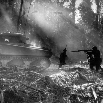 Following in the cover of a tank, American infantrymen secure an area on Bougainville, Solomon Islands, in March 1944 - Guadalcanal and HMAS Canberra Anniversary Tour