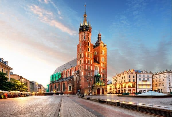 Poland - Old city center view with Adam Mickiewicz monument and St. Mary's Basilica in Krakow - Mat McLachlan Battle Tours
