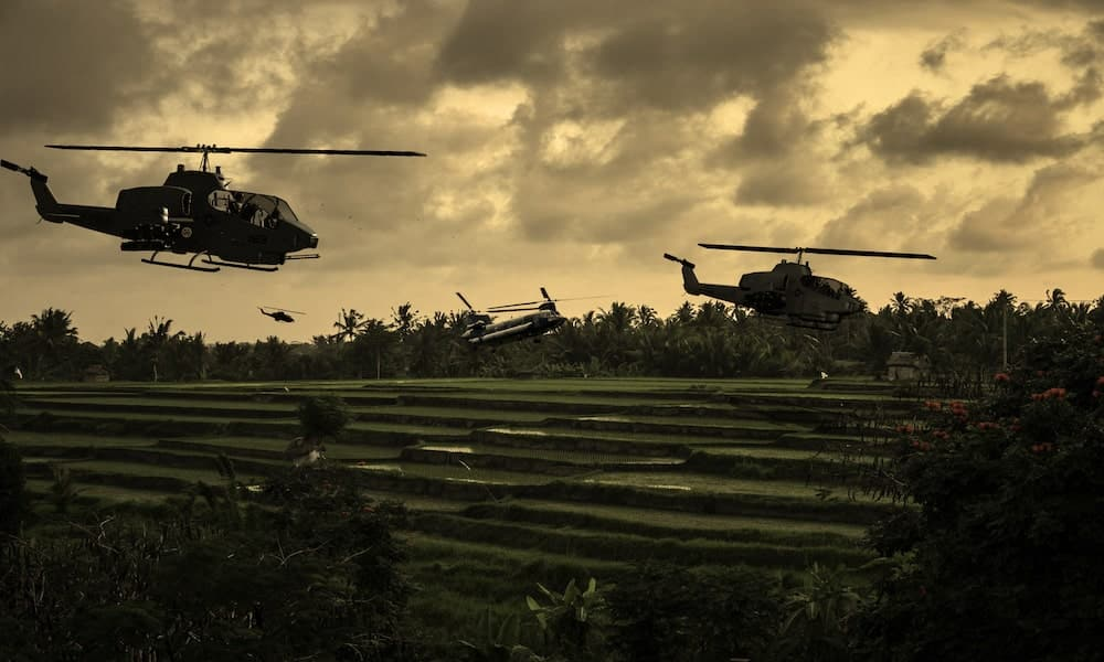 1970 helicopters flying over South Vietnamese rice paddies looking for the North Vietnamese Army - US Battle Tours